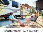 young couple sits near camping... | Shutterstock . vector #675160534