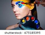 makeup artist applies colorful... | Shutterstock . vector #675185395