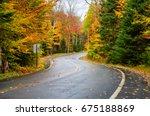 deserted winding forest road on ... | Shutterstock . vector #675188869