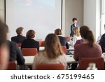 female speaker giving... | Shutterstock . vector #675199465