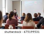 female speaker giving... | Shutterstock . vector #675199531