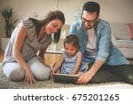 family lying on the floor with... | Shutterstock . vector #675201265