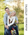 laughing couple on a bike in... | Shutterstock . vector #67523761