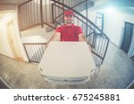 pizza delivery man in front of... | Shutterstock . vector #675245881