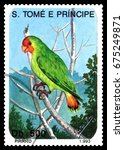 Small photo of STAVROPOL, RUSSIA - July 10. 2017: A stamp printed in Sao Tome and Principe shows bird Red-faced Lovebird (Agapornis pullaria), circa 1993