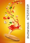 tasty pizza and falling... | Shutterstock . vector #675255319