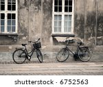 Two Bicycles In Front Of Grung...