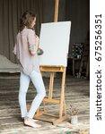 female artist working on... | Shutterstock . vector #675256351