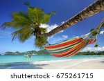 recreation in a hammock at... | Shutterstock . vector #675261715