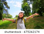 Small photo of Portrait of little girl smiling outside