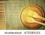 wooden plate on wooden... | Shutterstock . vector #675285151