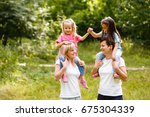 two mothers and two small... | Shutterstock . vector #675304339