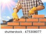 bricklayer. | Shutterstock . vector #675308077
