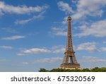 eiffel tower against blue sky... | Shutterstock . vector #675320569