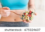 young woman eating a healthy... | Shutterstock . vector #675324637