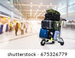 airport luggage trolley with... | Shutterstock . vector #675326779