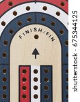 Small photo of concept of finished or ending, as shown by the finish peg on a cribbage board