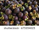 mangosteen. a pile of... | Shutterstock . vector #675354025