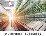 rolls of industrial cotton... | Shutterstock . vector #675368551