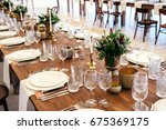 wedding table decorated in the... | Shutterstock . vector #675369175