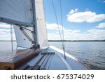 sail boat sailing on the river... | Shutterstock . vector #675374029