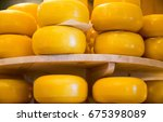 Stack Of Cheese In A Store At...