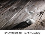 hourglass as time passing... | Shutterstock . vector #675406309