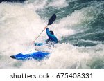 side view of a male kayaker... | Shutterstock . vector #675408331