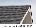 grey and black roof shingles of ... | Shutterstock . vector #675411205