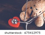 health care teddy bear heart... | Shutterstock . vector #675412975