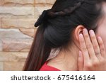 tinnitus  young woman has pain... | Shutterstock . vector #675416164