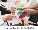 team of businessmen work... | Shutterstock . vector #675458959