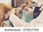 glad cheerful hairdresser... | Shutterstock . vector #675517705