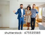 happy family with real estate... | Shutterstock . vector #675535585