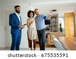 young couple with real estate... | Shutterstock . vector #675535591