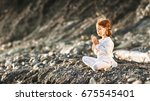 happy child girl meditates in... | Shutterstock . vector #675545401