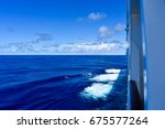 calm ocean view from board of a ... | Shutterstock . vector #675577264