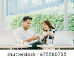 young asian couple  coworkers ... | Shutterstock . vector #675580735