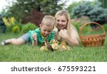 mother and son lying on grass... | Shutterstock . vector #675593221