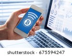 person sending bitcoin with... | Shutterstock . vector #675594247