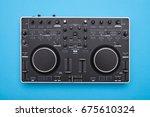 flat lay of modern dj mixer on... | Shutterstock . vector #675610324