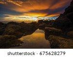 sunset reflection at teluk... | Shutterstock . vector #675628279