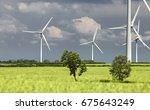 wind turbines generators on... | Shutterstock . vector #675643249