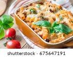 ziti bolognese in baking dish ... | Shutterstock . vector #675647191