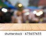 empty dark wooden table in... | Shutterstock . vector #675657655