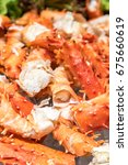 Small photo of alaskan king crab and seafood on ice