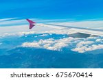 wing of an airplane flying... | Shutterstock . vector #675670414