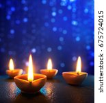 happy diwali   diya lamps lit... | Shutterstock . vector #675724015