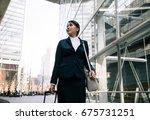 young businesswoman walking... | Shutterstock . vector #675731251