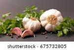 garlic with parsley | Shutterstock . vector #675732805